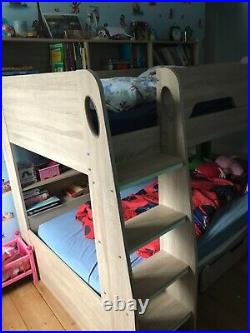 Kids bunk bed with shelves