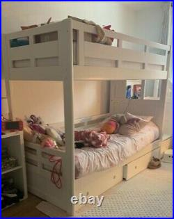 White wooden bunk bed with drawers/ storage and includes mattresses