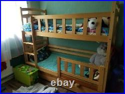 Wooden bunk bed with 2 lagre shelves and mattress